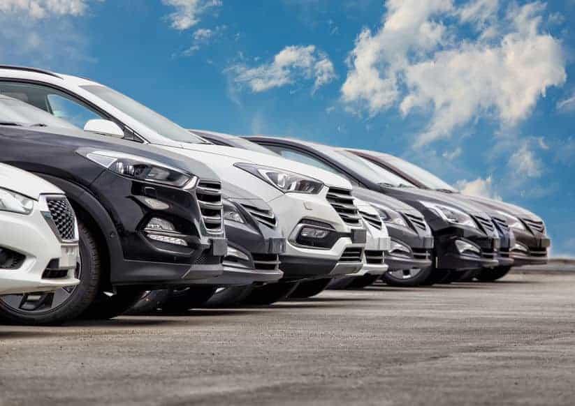 Parking lot full of cars dealership