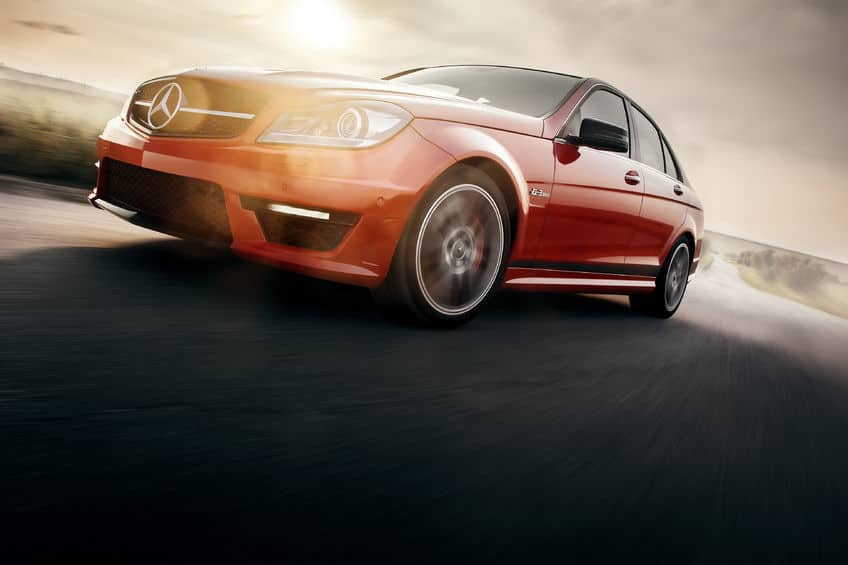 Mercedes-Benz driving on the road - red sports car