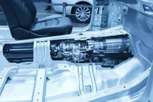 Car transmission mounted to the frame of the car