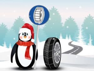 Tire wrapped in snow chains for the winter