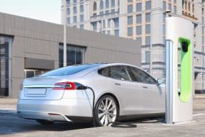 Tesla Model S being charged at a tesla supercharging station