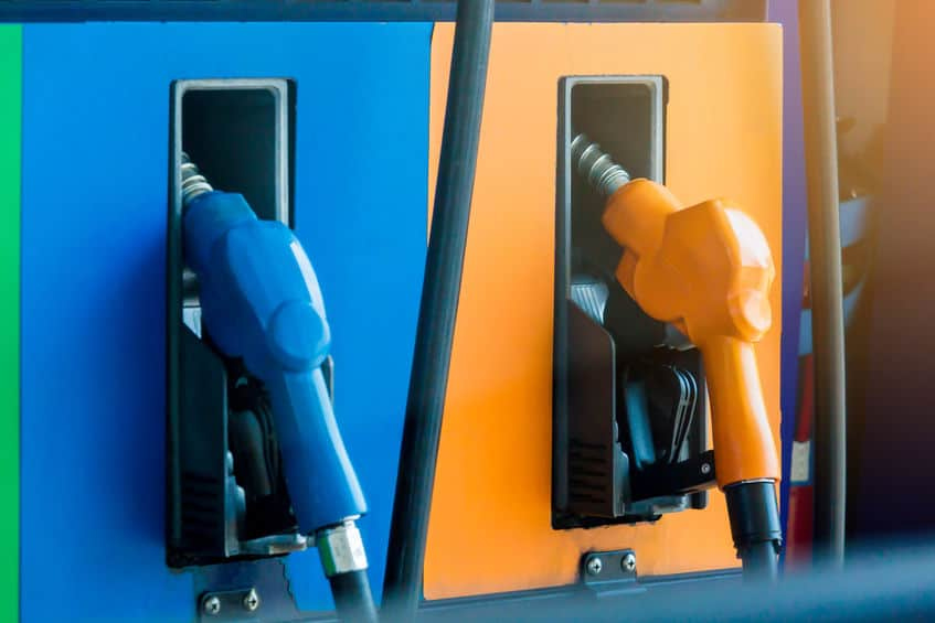 Close up fuel nozzles at a gas station