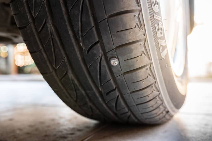 Car Tire with a Nail Puncture