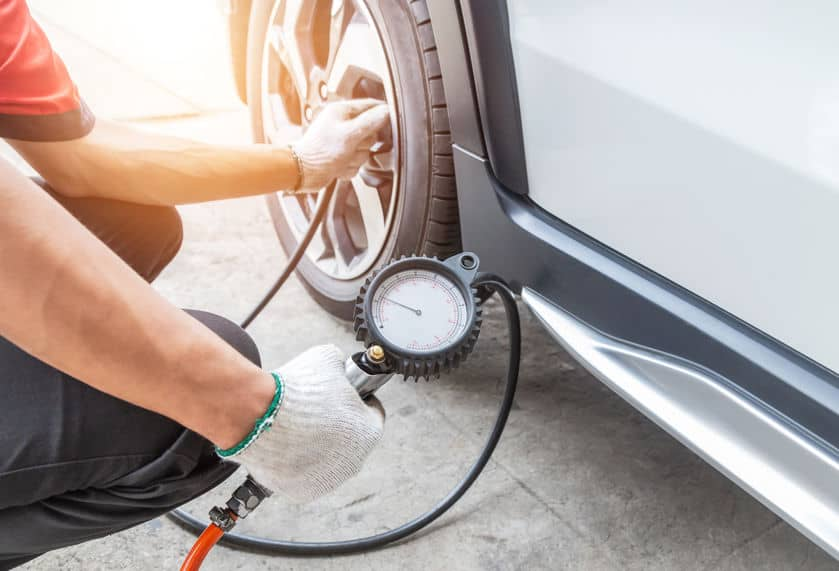 Check air pressure with a gauge and inflating the tire