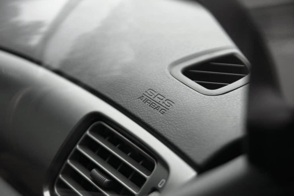 Passenger-side dash airbag