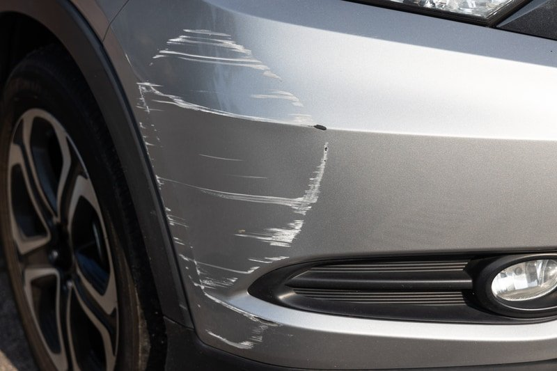 Car scratch with damaged body paint
