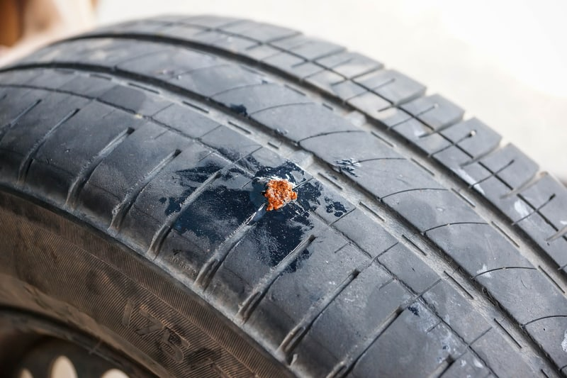 Car-tire-Sealing-the-string-plug-after-repair