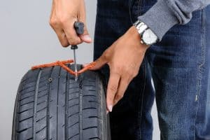 Car tire - inserting the string plug