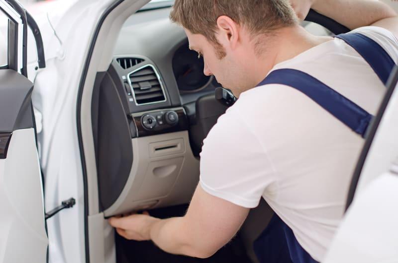 Mechanic-removing-dash