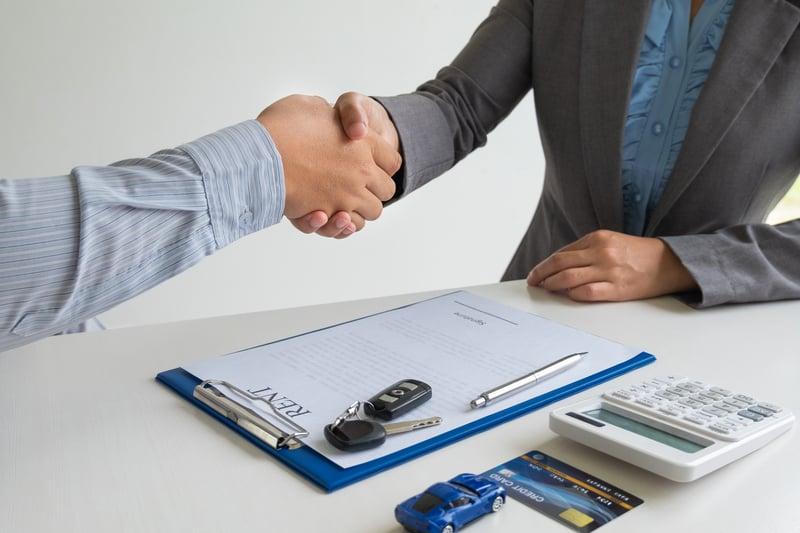 Car dealership shaking hands