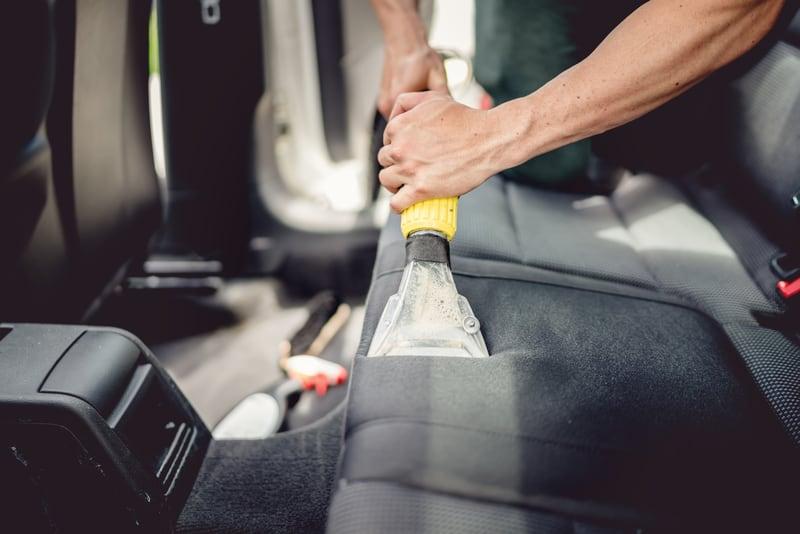 Car detailing vacuuming