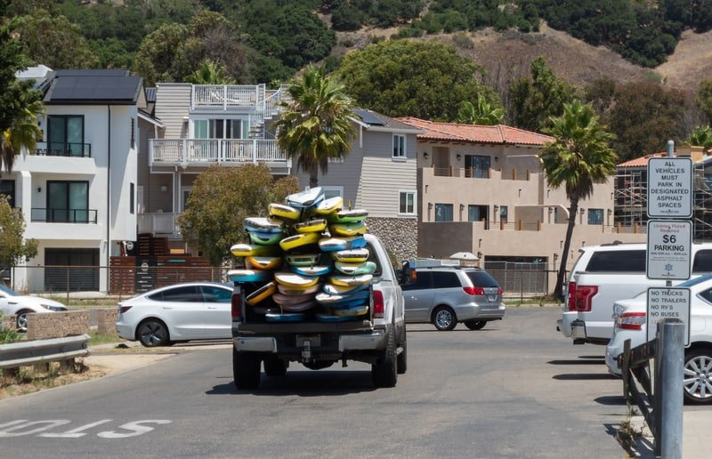 Pickup truck with surfboards stacked up