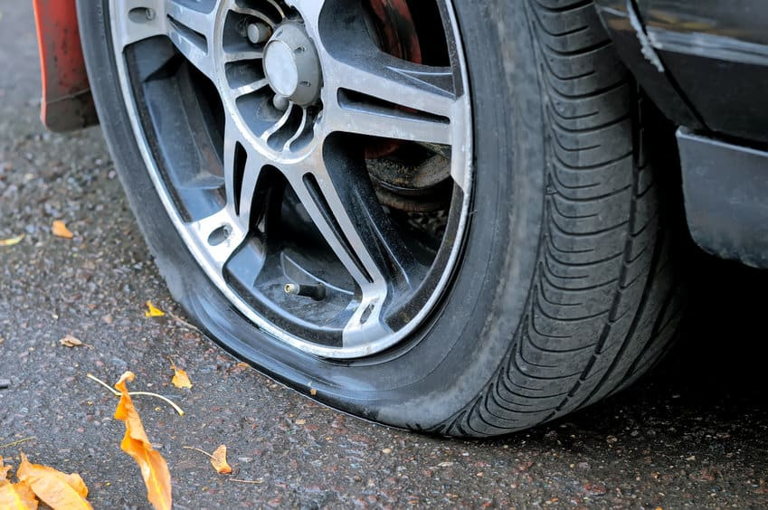 Flat tire of a car on the pavement