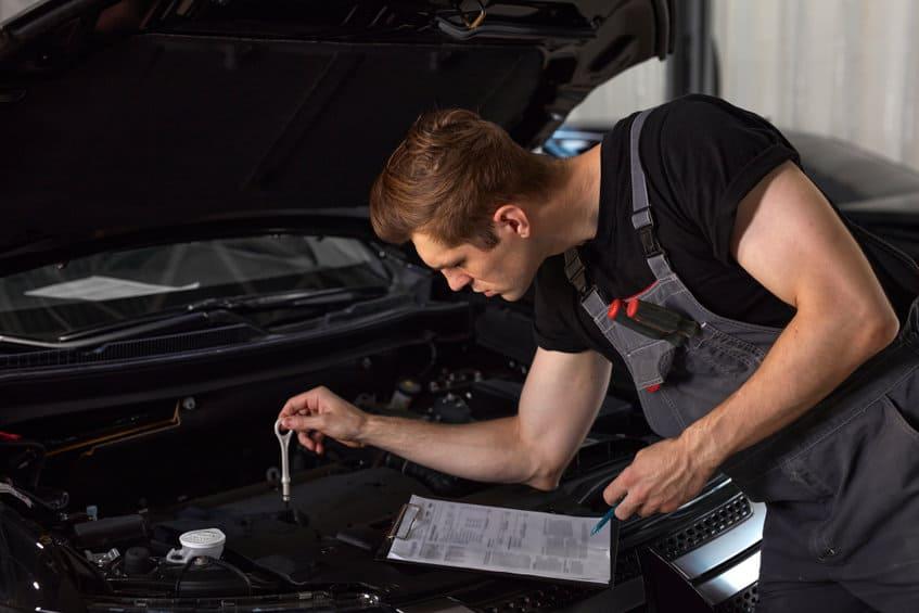 Mechanic checking the oil level