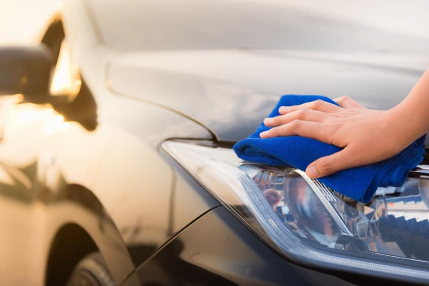 Wiping down car with microfiber towel