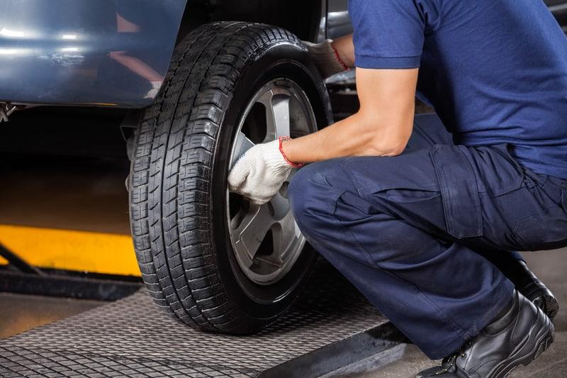 Mechanic fixing a car tire