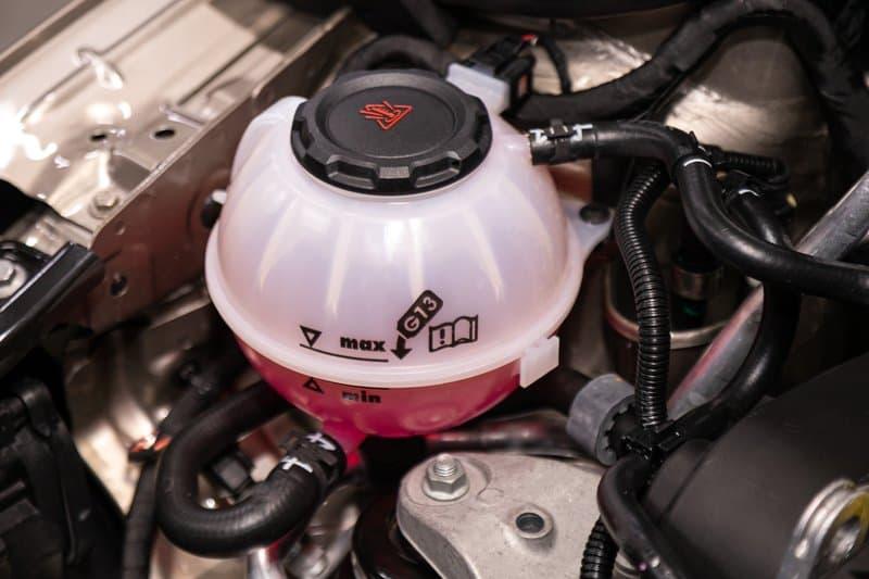 Car engine coolant reservoir