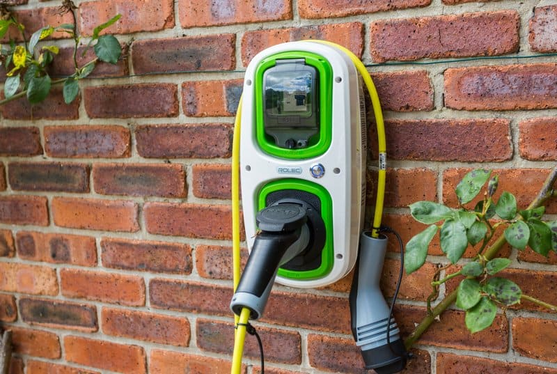 Electric car charger hard-wired wall mounted