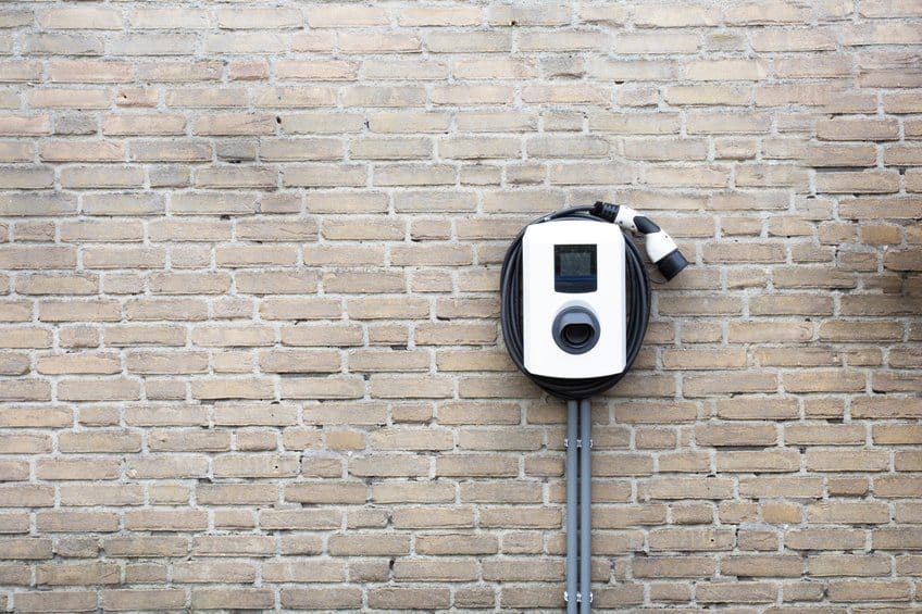 Electric car charger hard-wired outside on the wall EV