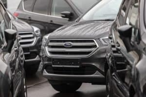 Ford cars in the parking lot with rain