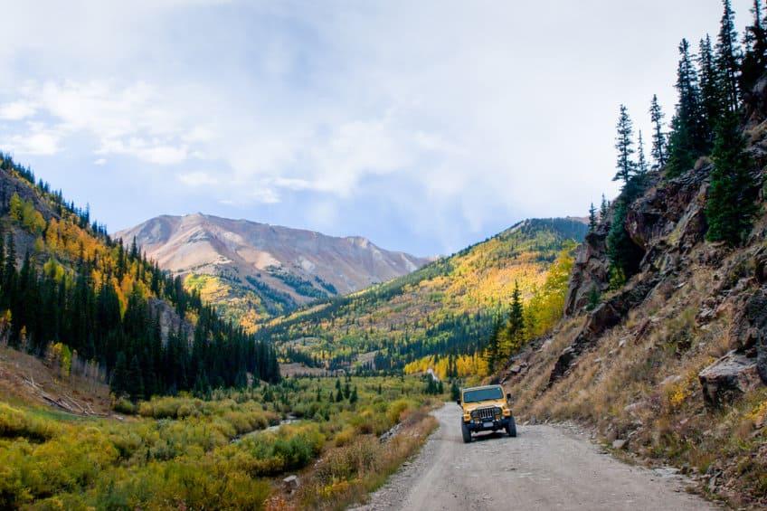Yellow Jeep on Cinnamon Pass, Colorado in autumn.