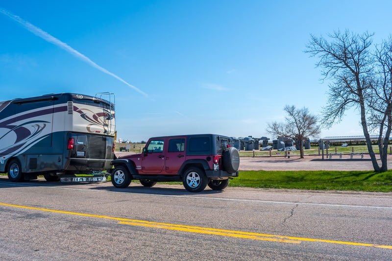 Jeep being towed by an RV