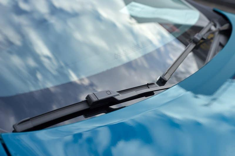 Blue car with brand new premium windshield wipers installed