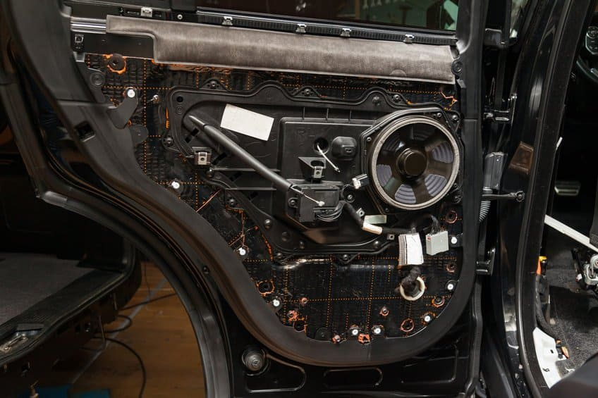Car audio speaker mounted to the side door