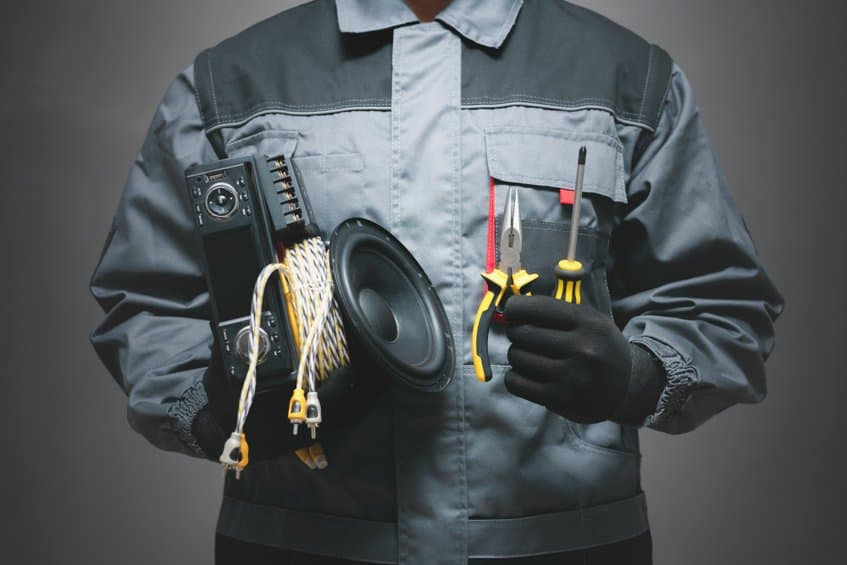 Car audio technician hold audio gear ready to install