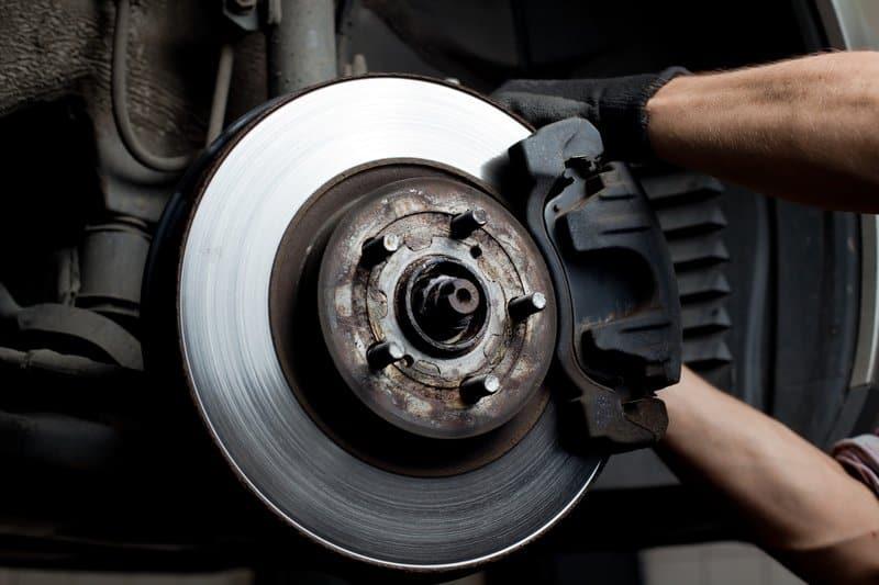 Car brake rotor with brake pads on