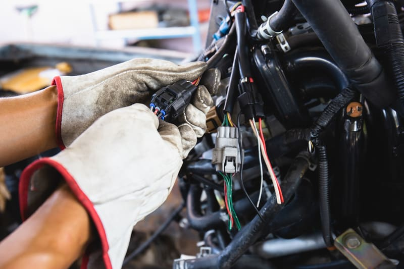 Close up of a mechanic inspecting the car wiring