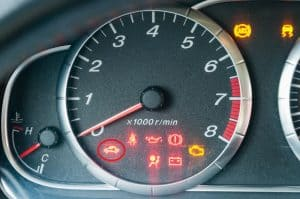 Instrument cluster showing diagnostic lights with the security light on