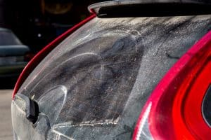 Windshield wiper on the rear of the car with dirty dry streaks
